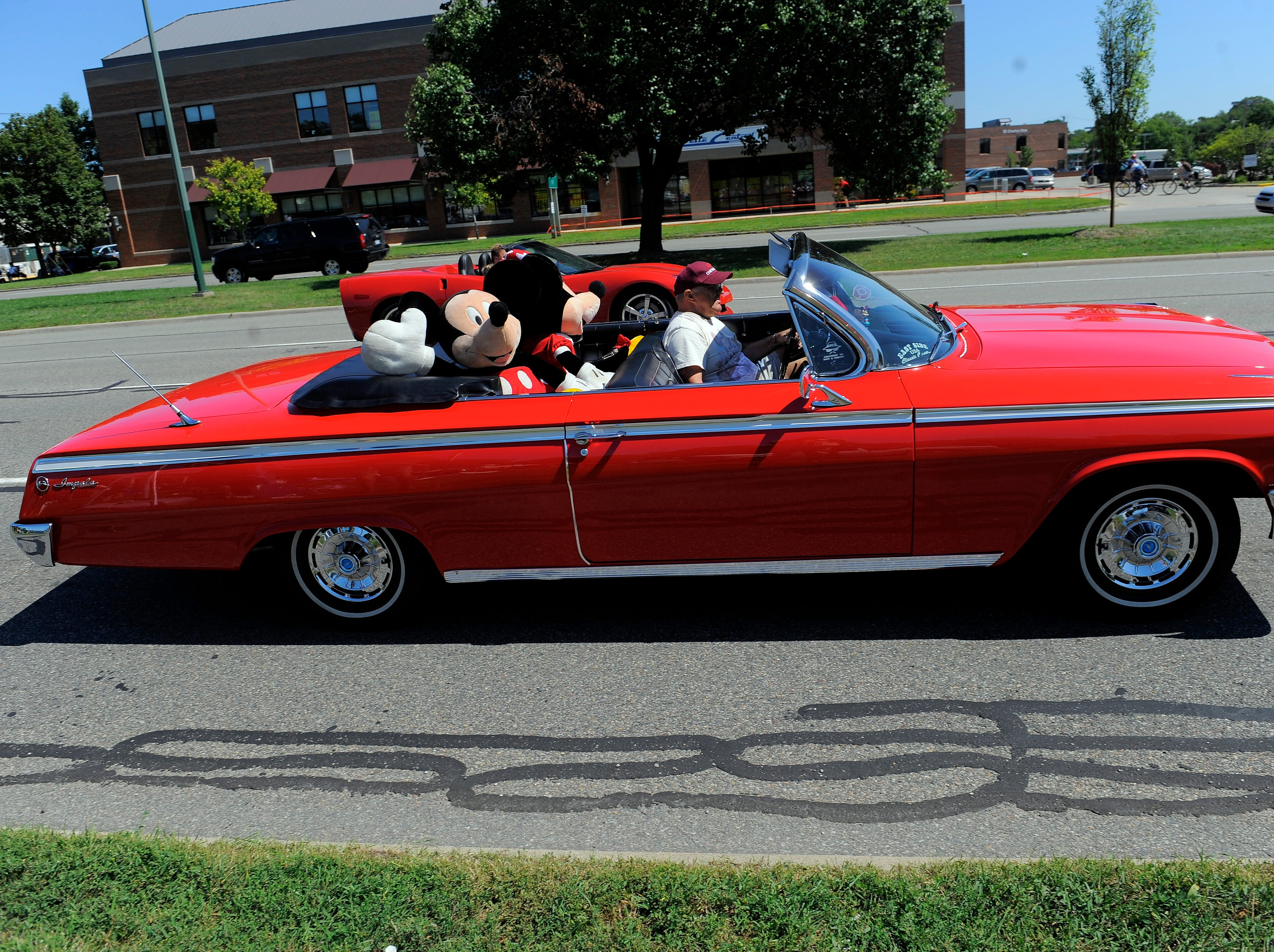 A 1963 Chevrolet Impala convertible filled with stuffed animals heads south on Woodward, Friday  Aug. 19, 2011.