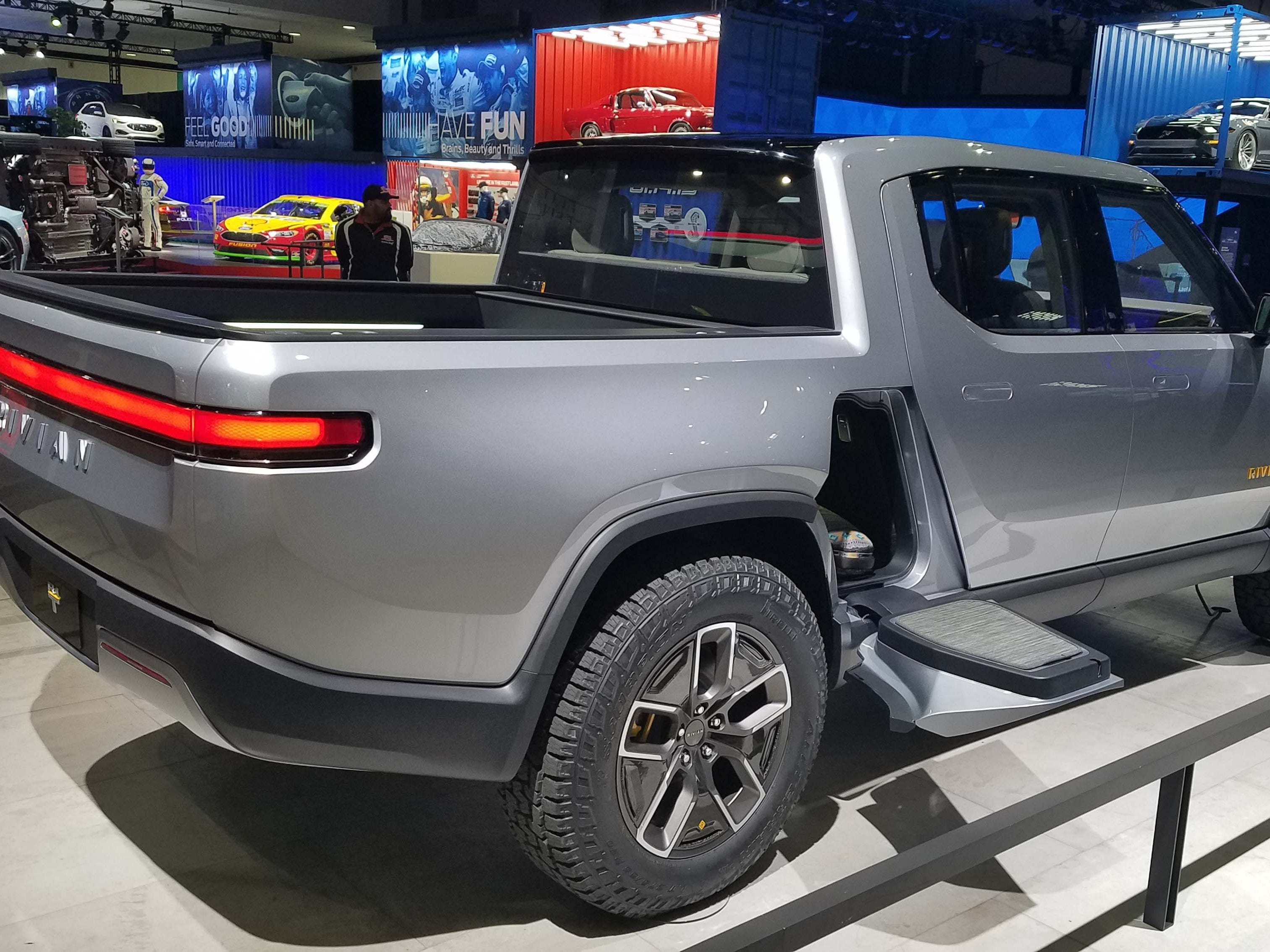 The Rivian pickup packs up 400 miles of range, sports neat tweaks like a side seat, and can carry cargo in its front frunk.