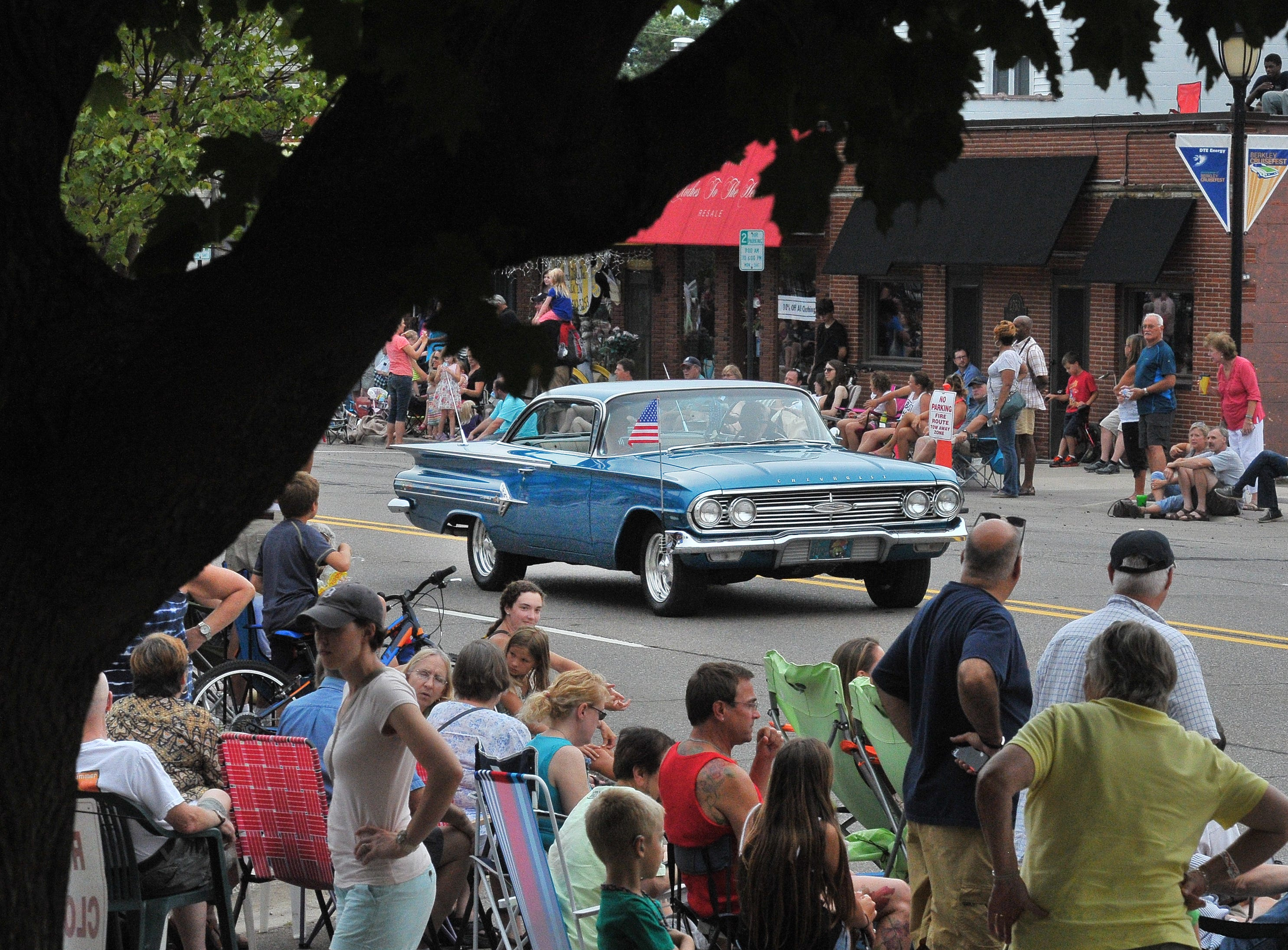 A 1960 Impala makes its way down 12 Mile for the Berkley Cruisefest parade, Aug. 14, 2015.