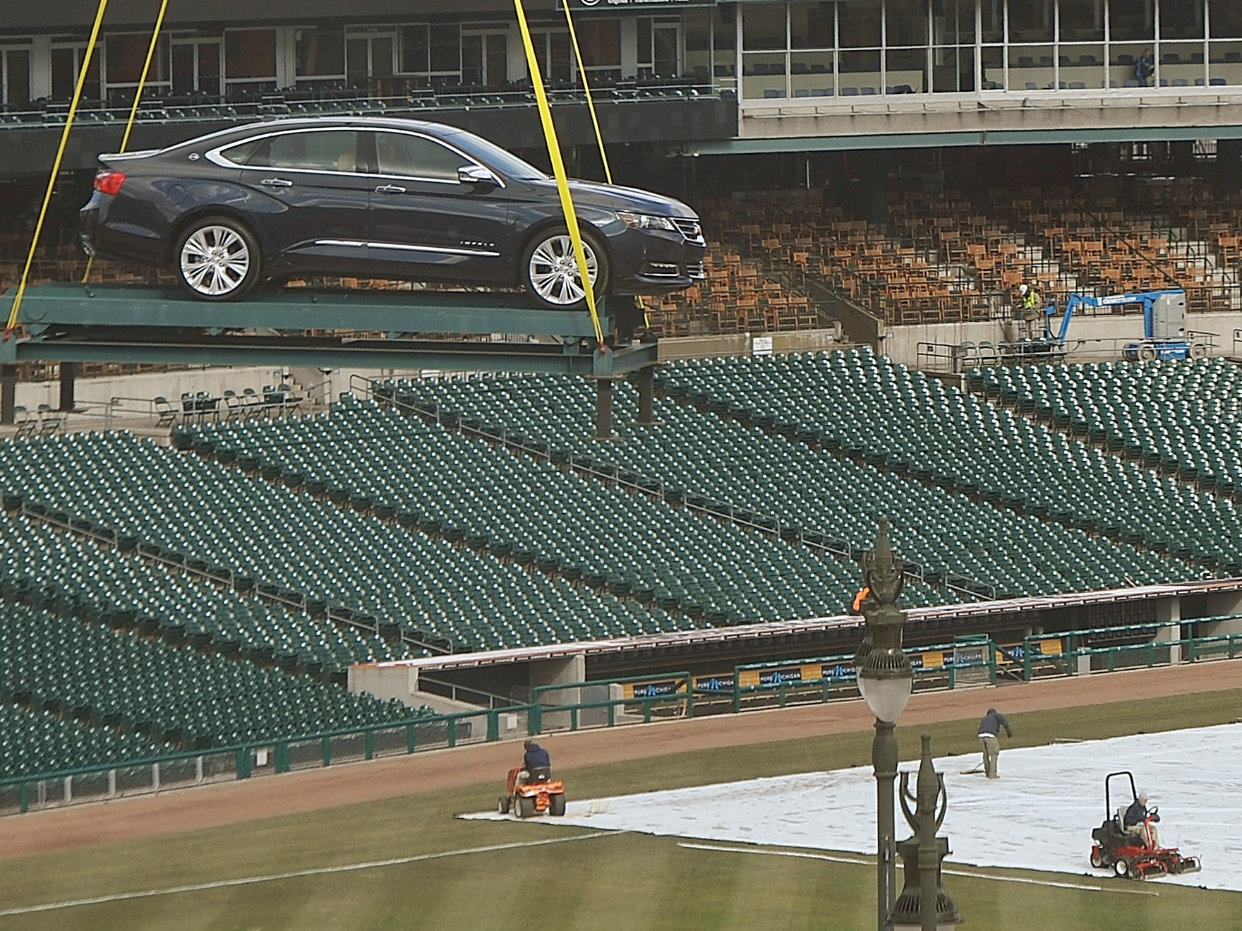 A 2014 Impala is lifted to the top of the Chevrolet fountain at Comerica Park in Detroit on April 1, 2013.