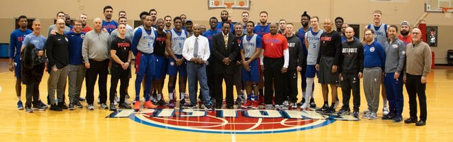 The Pistons pose for a shot with guest visitor Thomas Hearns.