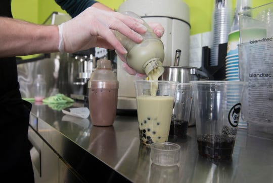 Milk Tea is pour from a shaker at Mr. Bubble Tea located off Green River Road on Evansville's East Side.