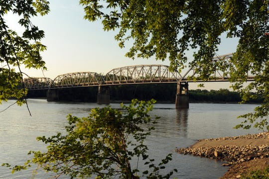 The Harmony Way Bridge, which connects New Harmony, Ind., to southeastern Illinois over the Wabash River, is on the top ten list of Indiana's most endangered landmarks.  The bridge, which is on the National Register of Historic Places, remains open but is need of repairs.
