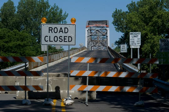 The bridge that spans the Wabash River and connects the small Indiana town of New Harmony with White County, Ill., is officially closed as of Monday afternoon, May 21, 2012. A team of nine engineers on April 29, 2012, deemed the bridge too dangerous to remain open due to major structural problems with the aging historic landmark.