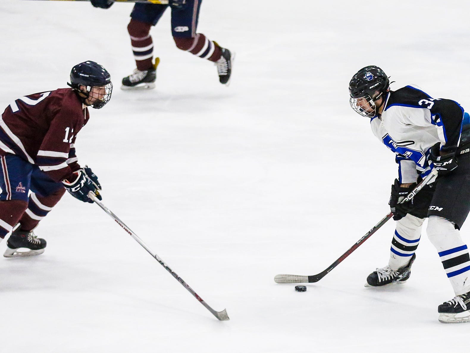 St. Mary's Springs Academy co-op hockey's Cade Sabel tries to get past Appleton United's Trevor Tomada during their game Thursday, November 29, 2018 played in Fond du Lac. Springs won the game 8-1. Doug Raflik/USA TODAY NETWORK-Wisconsin