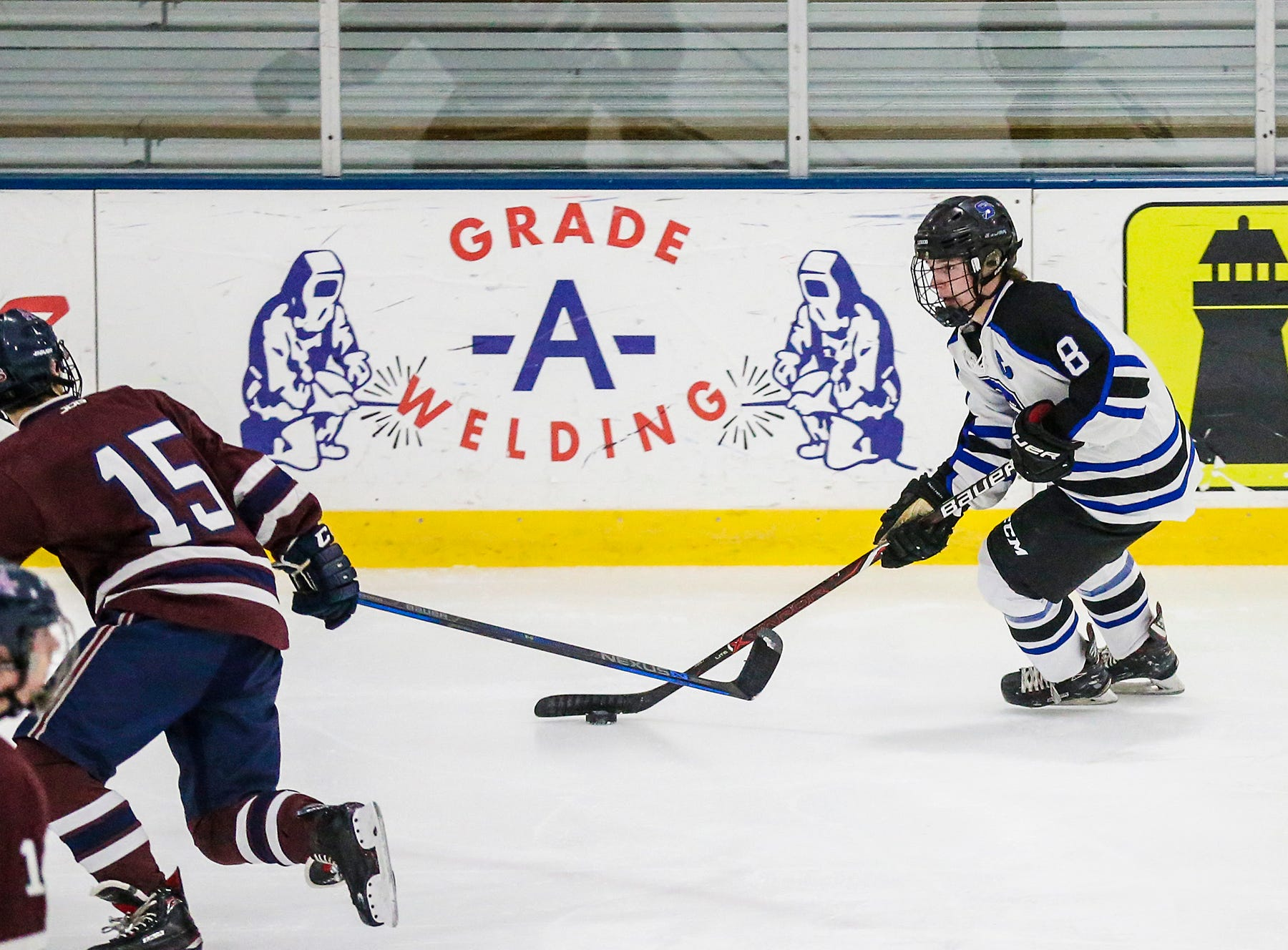 St. Mary's Springs Academy co-op hockey's Zach Welsch works the puck against Appleton United's Brenden Ryan during their game Thursday, November 29, 2018 played in Fond du Lac. Springs won the game 8-1. Doug Raflik/USA TODAY NETWORK-Wisconsin