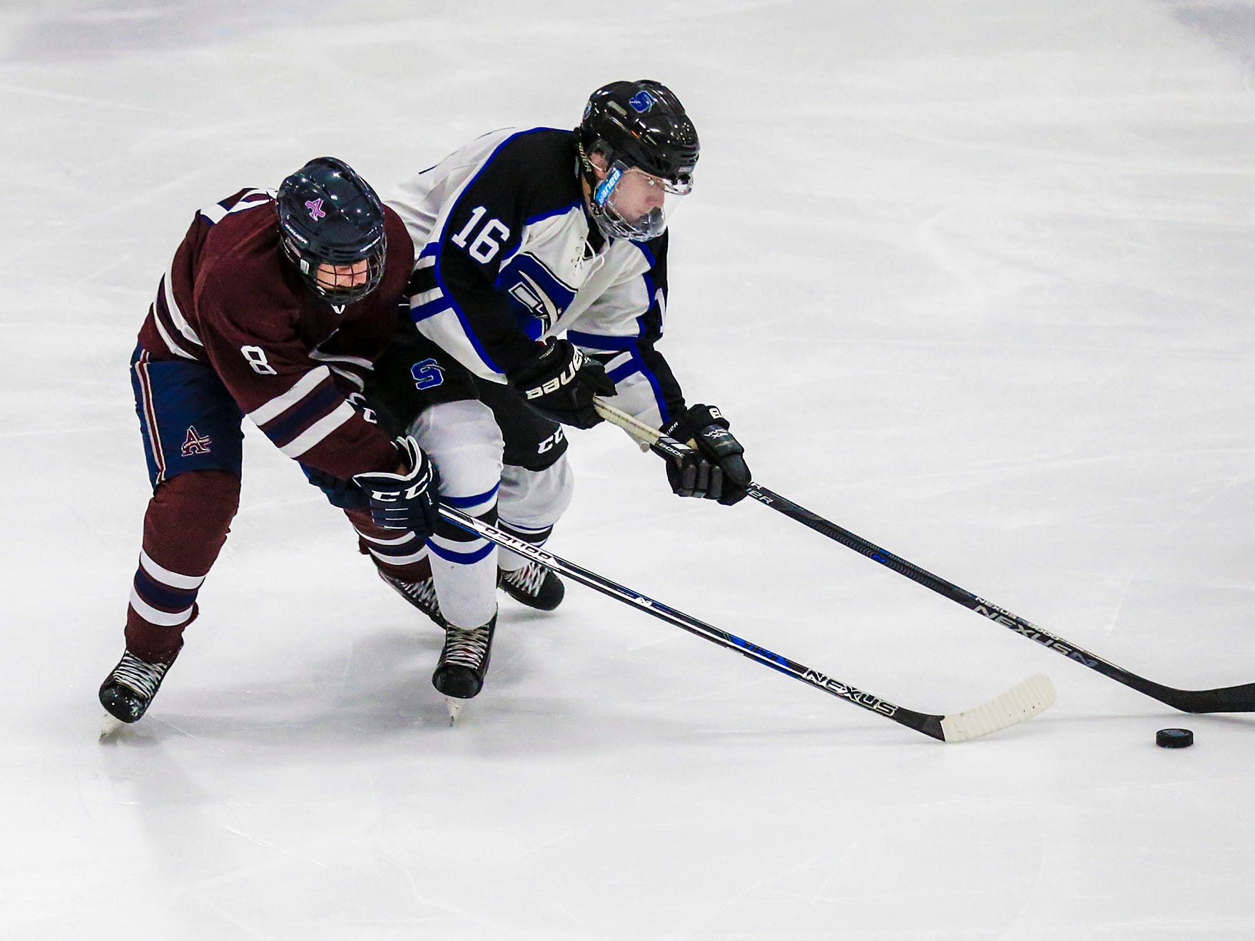 St. Mary's Springs Academy co-op hockey's Caleb Schaefer battles for the puck against Appleton United's Josh Christofferson during their game Thursday, November 29, 2018 played in Fond du Lac. Springs won the game 8-1. Doug Raflik/USA TODAY NETWORK-Wisconsin
