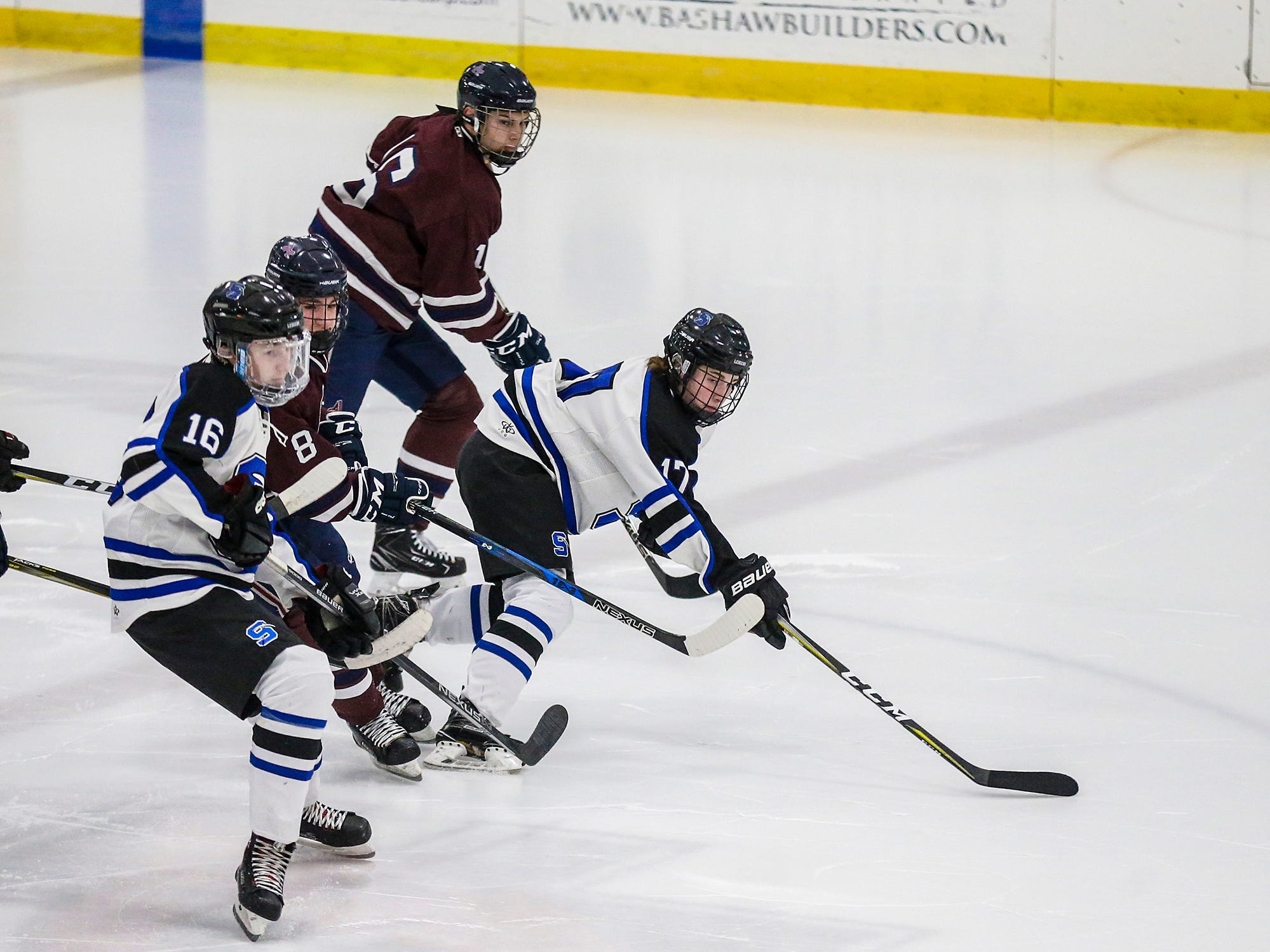St. Mary's Springs Academy co-op hockey's Caleb Schaefer (16) Calvin Grass (17) and Appleton United's Josh Christofferson (8) go after the puck during their game Thursday, November 29, 2018 played in Fond du Lac. Springs won the game 8-1. Doug Raflik/USA TODAY NETWORK-Wisconsin