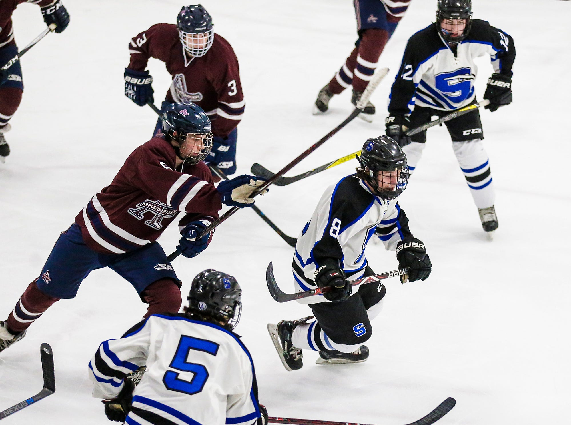 St. Mary's Springs Academy co-op hockey's Zach Welsch (8) and Brady Welsch (5) go after the puck against Appleton United during their game Thursday, November 29, 2018 played in Fond du Lac. Springs won the game 8-1. Doug Raflik/USA TODAY NETWORK-Wisconsin