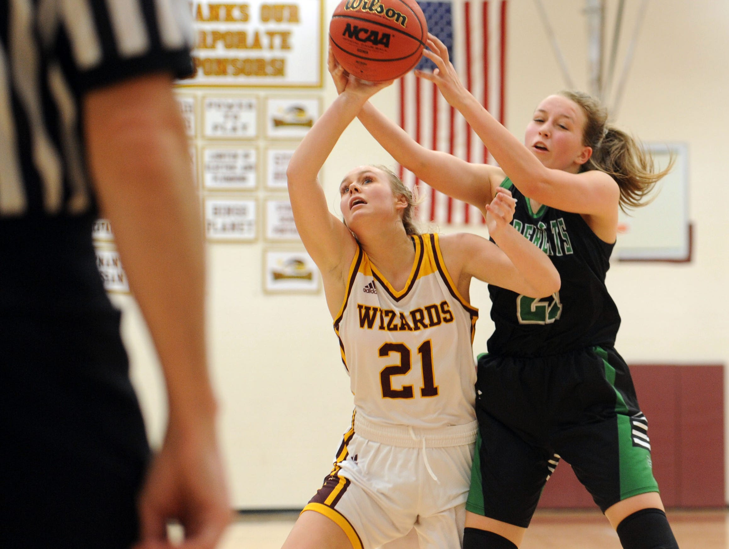 Windsor's Payton Kramer tries to get a rebound from Fossil Ridge's Kaysen Hobbs during the game Thursday at Windsor High School.