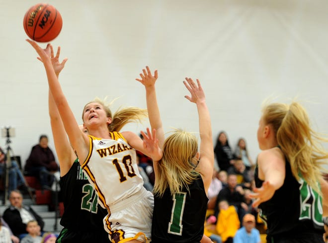 Windsor's Hollie Hoffman makes a layup as Fossil Ridge's Alexis Kohler tries to block her during the game Thursday at Windsor High School.