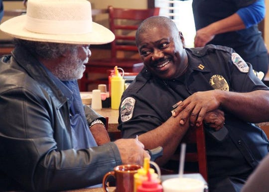 A 2014 photo shows then-Capt. Melvin Perry, of the Fort Myers Police Department, at a coffee with a cop event at Utopia Soul Food Cafe.