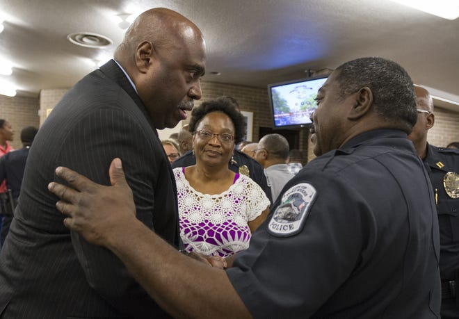 A photo take in 2016 shows then-Capt. Melvin Duke Perry congratulating newly-sworn Fort Myers police Chief Derrick Diggs.