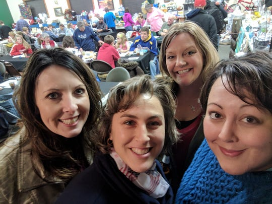 Members of the Holy Trinity Parish Auction committee are Danielle Perrizo, Amy Huggett, Hollie Viestenz, Sara Van Ess.