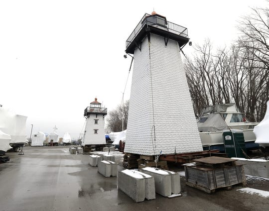 The Grassy Island Range Lights have been removed from the breakwall at the Green Bay Yachting Club as work proceeds on restoration of the breakwall and the bases of the lighthouses. The range lights were salvaged and restored by Merlin Baenen and Wayne Dunbar who spearheaded the drive to create a secure site for the structures.