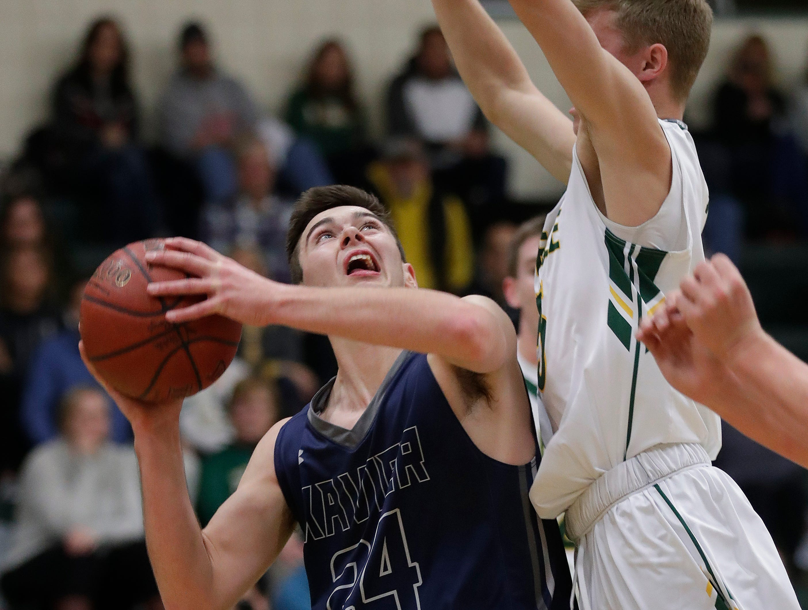 Xavier High School's Nick Otto works down low against Preble against Thursday, November 29, 2018 at Preble High School in Green Bay, Wis.
