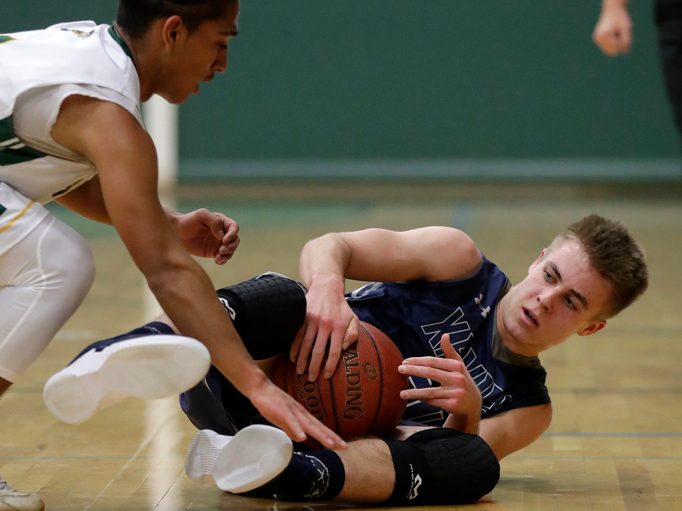 Xavier High School's Cal Mares goes after a loose ball  against Preble against Thursday, November 29, 2018 at Preble High School in Green Bay, Wis.