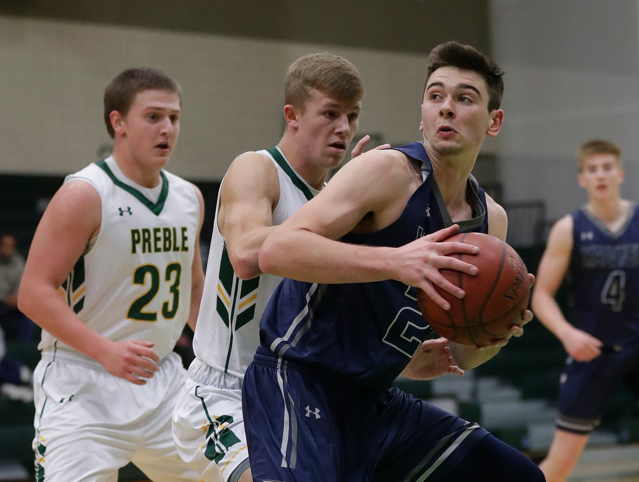 Xavier High School's Nick Otto spins down low against Preble Thursday, November 29, 2018 at Preble High School in Green Bay, Wis.