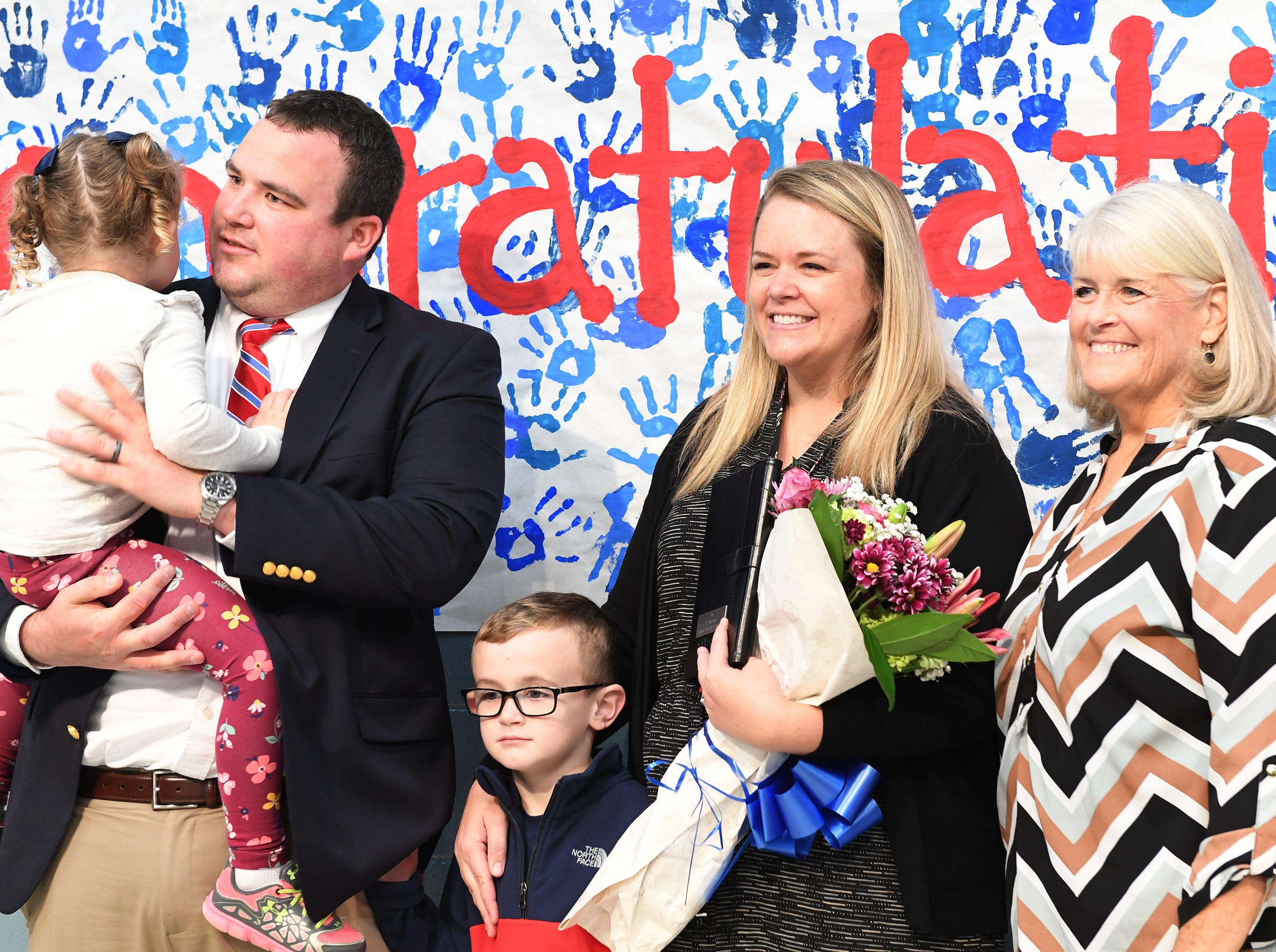 Simpsonville Elementary School Assistant Principal Leah Stafford's family including husband Todd, children Jackson, 5, and Sara Kate, 3, and mother Cathy Ebel, were at the school for the surprise announcement that Stafford is the 2019 SC Elementary Assistant Principal of the Year, Friday, Nov. 30, 2018.