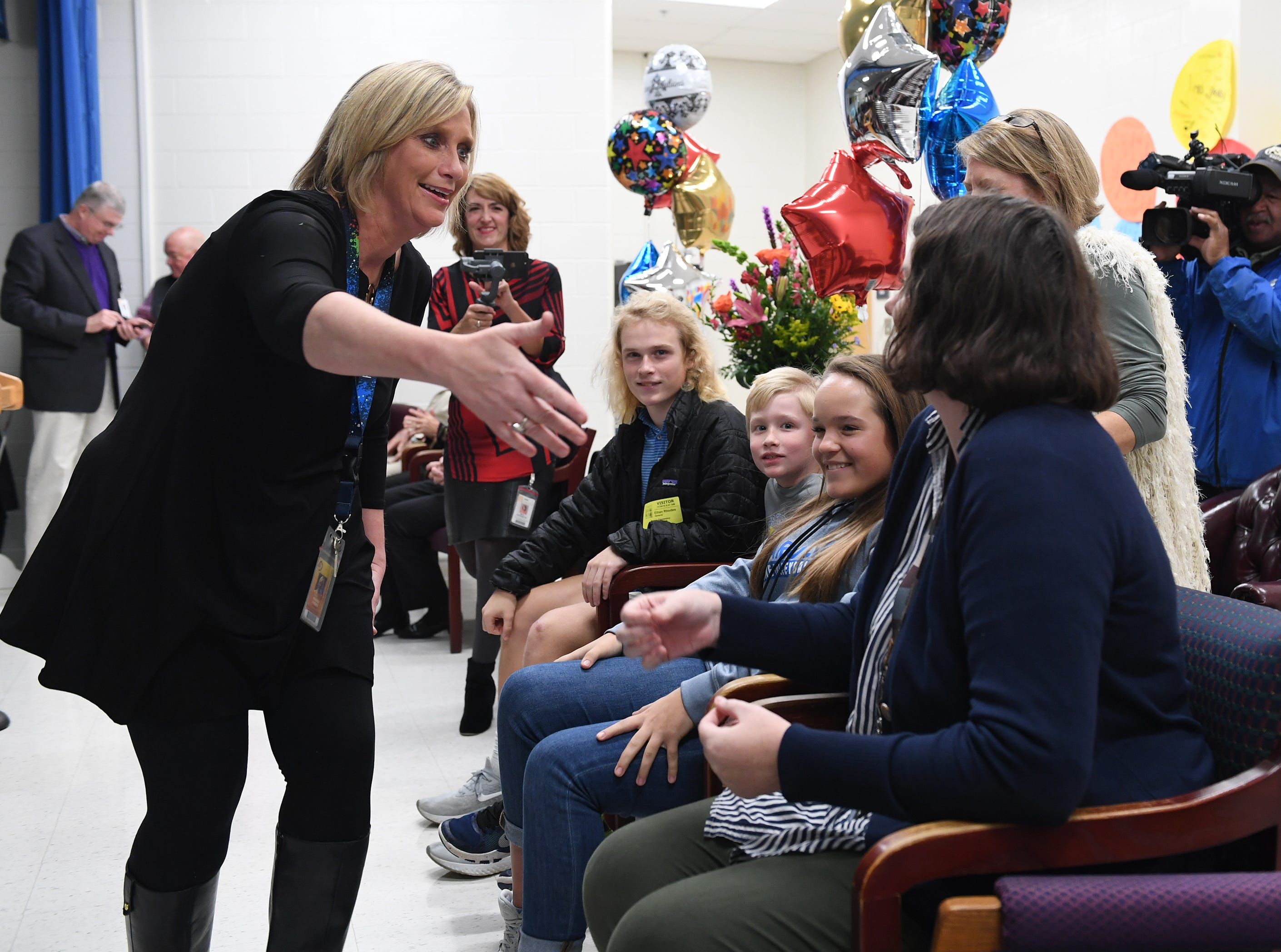 Principal Rhonda Rhodes greets her children who were on stage at Taylors Elementary School as a surprise when Rhodes was named the 2019 SC Elementary Principal of the Year Friday, Nov. 30, 2018.