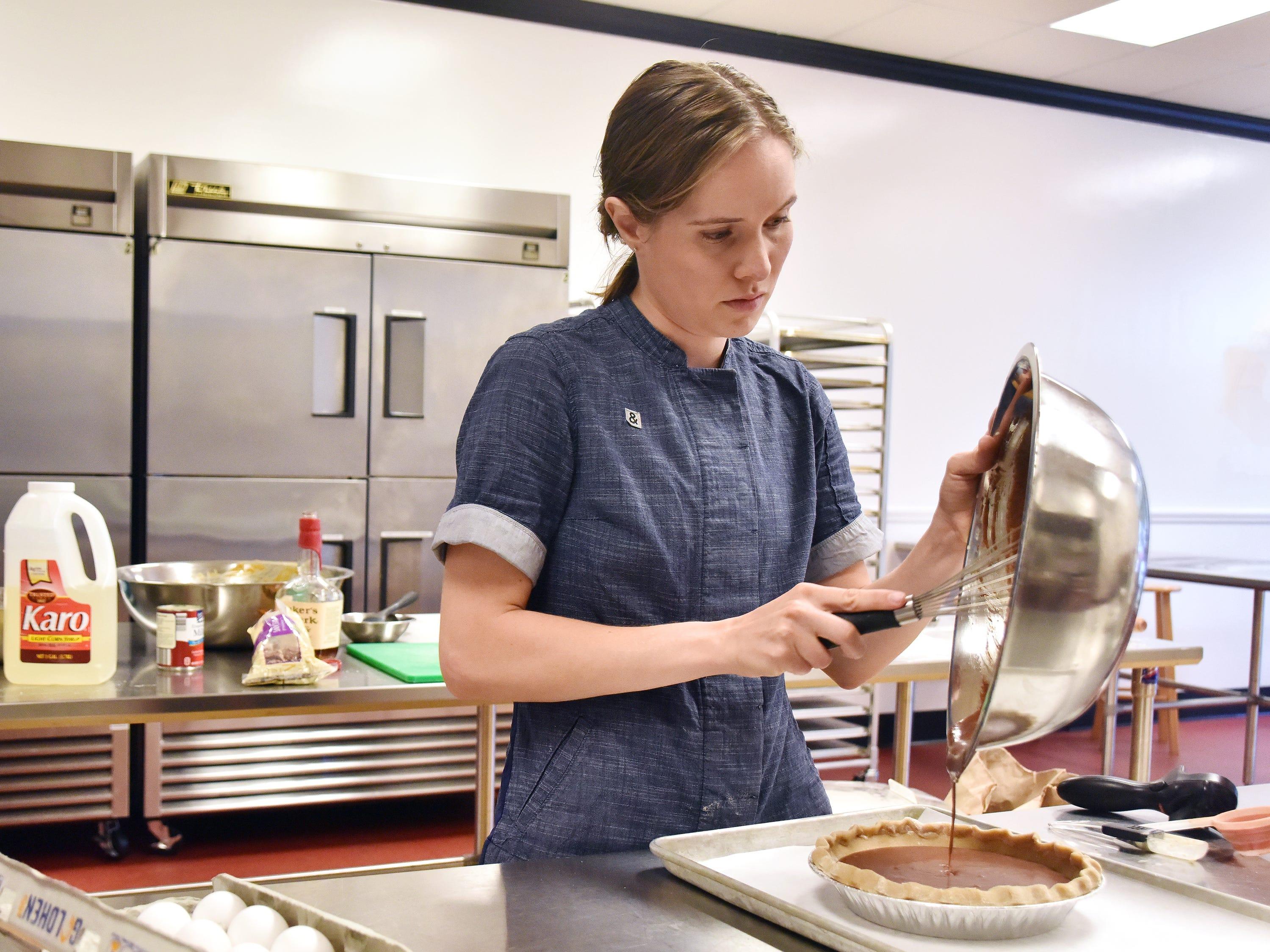 Jeannie Hall prepares pie at the Imagine Kitchen.