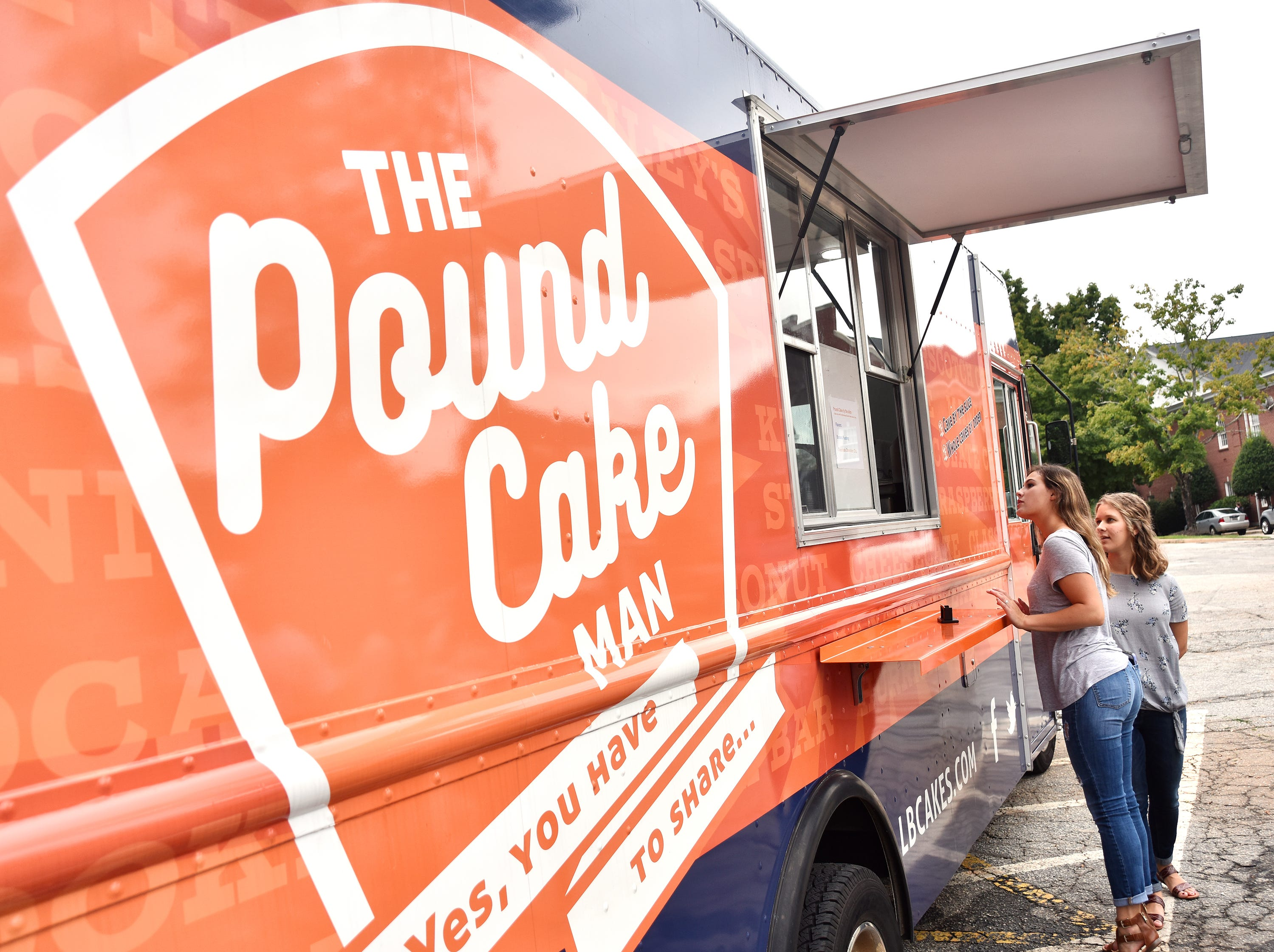 Anderson University students order from The Pound Cake Man food truck.