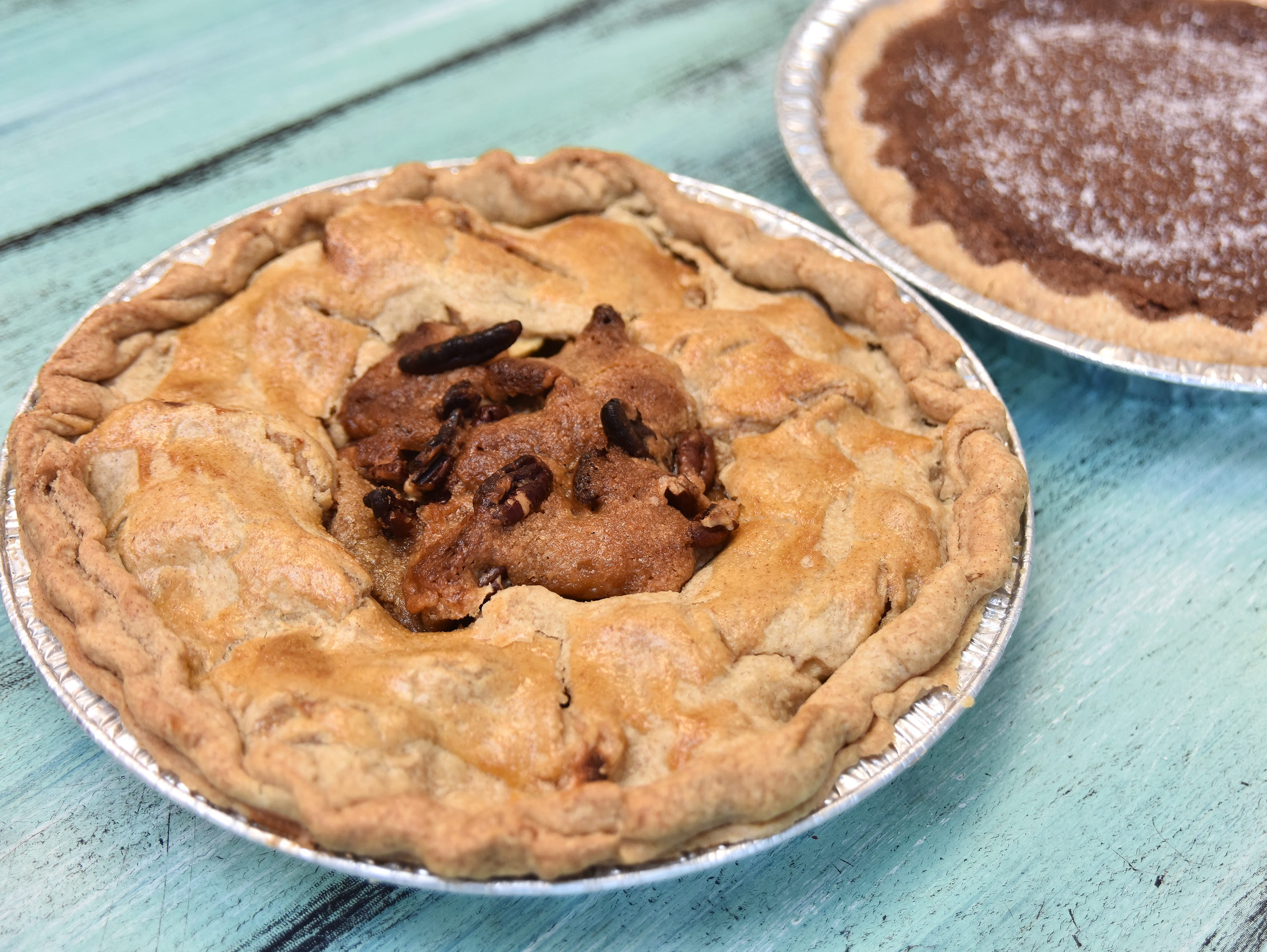 A bourbon apple pecan pie and a salted chocolate pie made by Jeannie Hall.