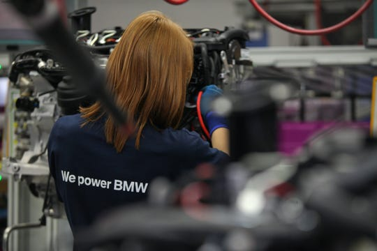 A BMW workers assembles an engine at the company's plant in Steyr, Austria, on June 6, 2012. Engines for SUVs made at BMW's Spartanburg plant are shipped from this and other European plants.