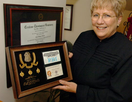 Carol Allison now displays her Erskine degree in her home office.