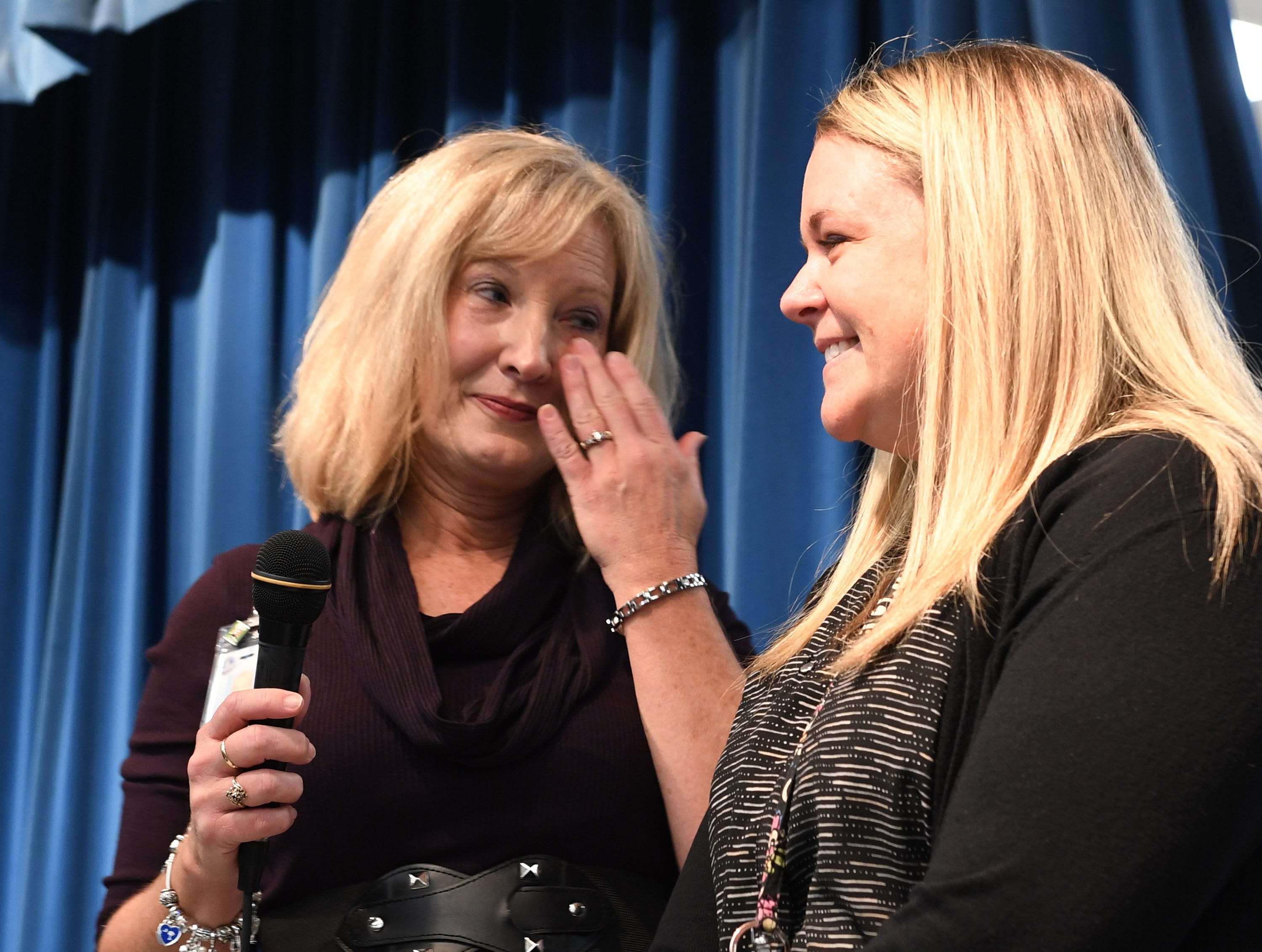 Simpsonville Elementary School Principal Jackie Earle brings Assistant Principal Leah Stafford on stage for the surprise announcement that Stafford is the 2019 SC Elementary Assistant Principal of the Year Friday, Nov. 30, 2018.