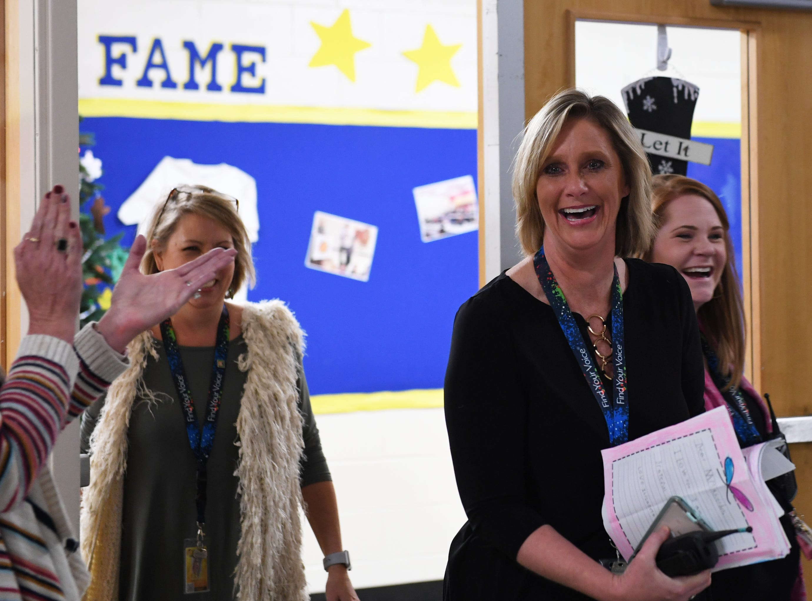 Principal Rhonda Rhodes walks into the cafeteria at Taylors Elementary School to a surprise gathering Friday, Nov. 30, 2018, where she was awarded as the 2019 SC Elementary Principal of the Year.