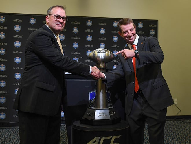 Clemson head coach Dabo Swinney, right, has some fun with Pittsburgh Head Coach Pat Narduzzi during the ACC Championship coaches press conference at Bank of America Stadium in Charlotte Friday, November 30, 2018.