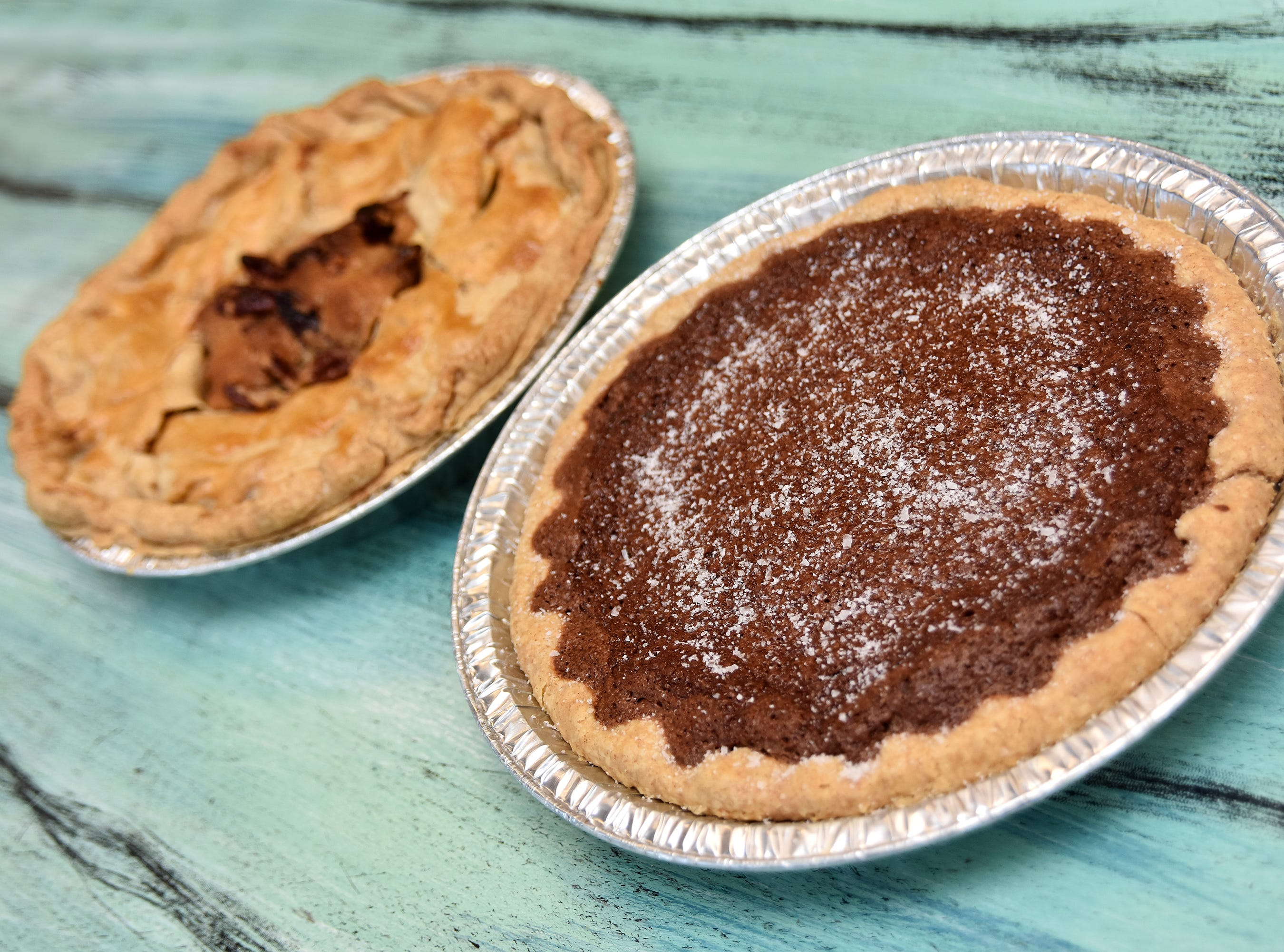 A salted chocolate pie and a bourbon apple pecan pie made by Jeannie Hall.