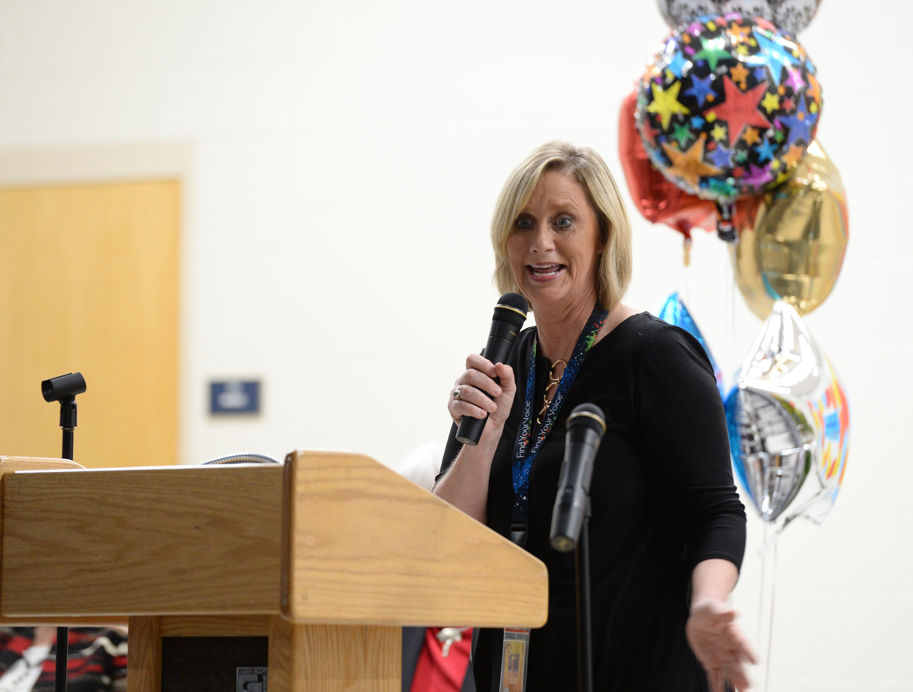 Principal Rhonda Rhodes talks to a crowd of students and faculty at Taylors Elementary School after she was named as the 2019 SC Elementary Principal of the Year Friday, Nov. 30, 2018.