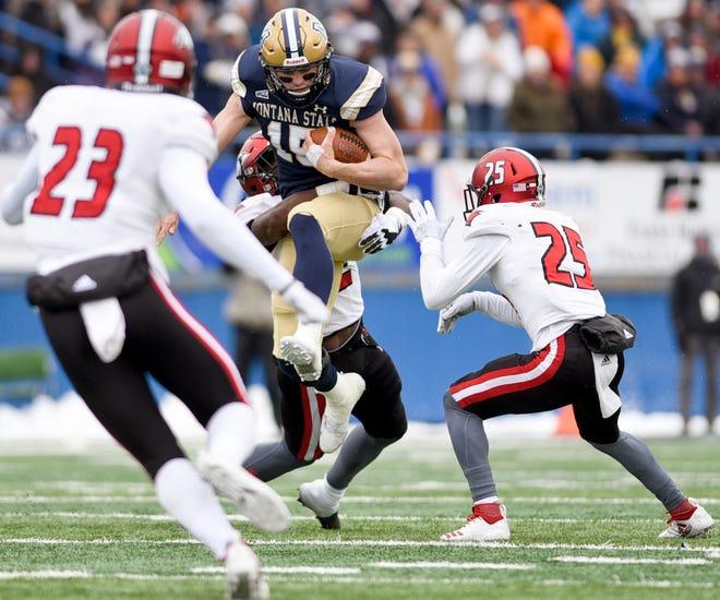 Montana State quarterback Troy Andersen tries to jump over Incarnate Word's Brandon McDuffie last week in Bozeman.