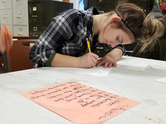 Riley Seawall, 12, writes a letter during Power Hour at Boys and Girls Club. She loves doing art projects and even working on her homework at Boys and Girls Club every day after school.