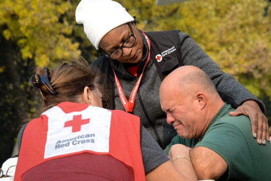 At the Neighborhood Church shelter in Chico, California, Daniel Nieves grieves the loss of his friends, who perished in the Camp Fire. Red Cross volunteers Pamela Harris and Vicki Eichstaedt listen and offer comfort as Daniel remembers a special friendship.