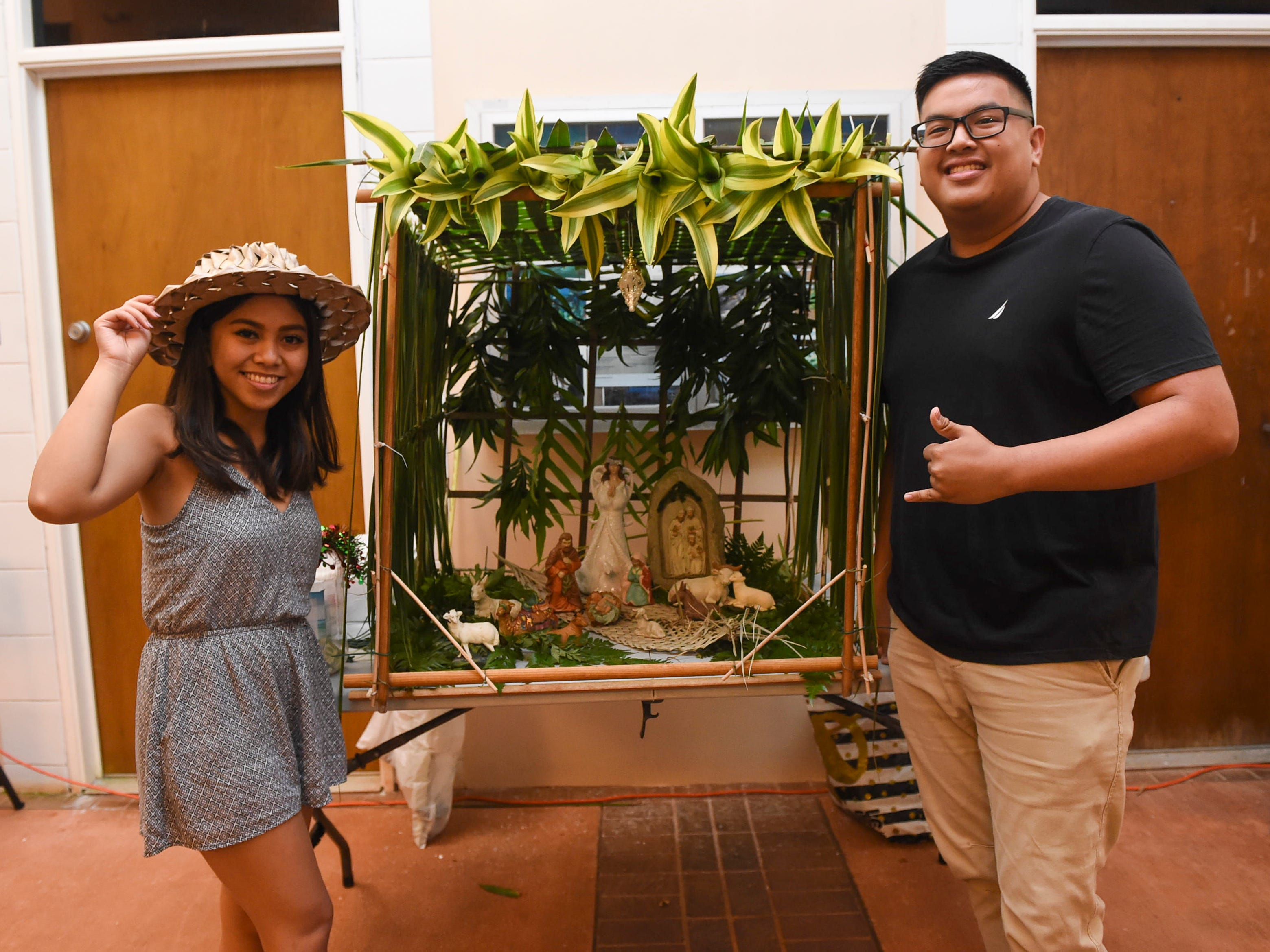 CHamoru language class students Jeanny Newby and Patrick ZGalimba with their bilen during the University of Guam Chamorro Studies Program's 2018 Christmas Celebration, Puengen Minagof Noche Buena! at the UOG Humanities and Social Sciences Building on Nov. 30, 2018.