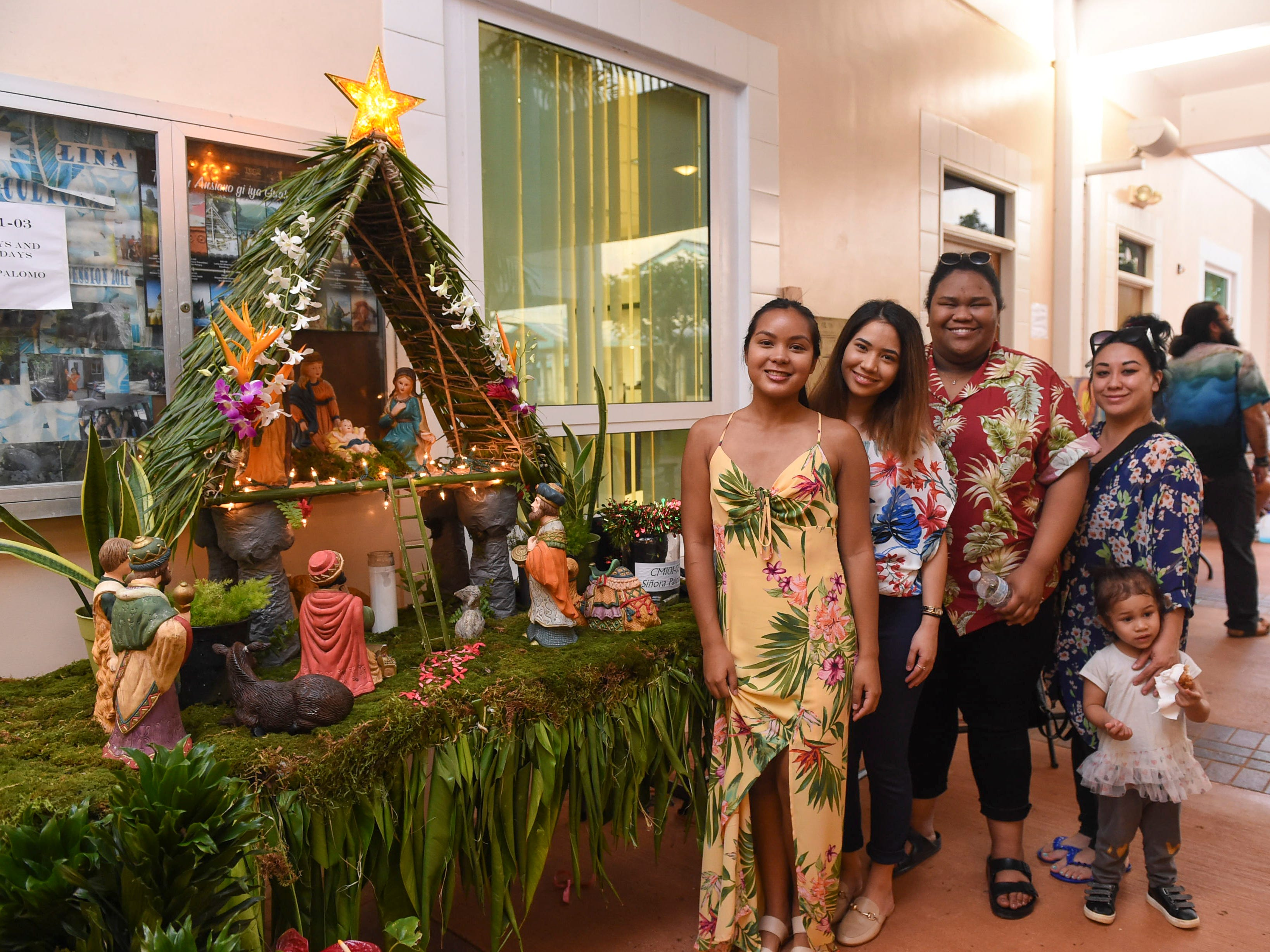 CHamoru language class students and their families stand beside their bilen during the University of Guam Chamorro Studies Program's 2018 Christmas Celebration, Puengen Minagof Noche Buena! at the UOG Humanities and Social Sciences Building on Nov. 30, 2018. From left: Aleiah Chargualaf, Cynthia Cruz, Mya Broussard, Kioni Walker and Chloe Walker, 2.