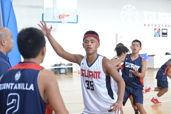 Guam U15 co-captain No. 35 Elijah Garrido defends an inbounds pass from the baseline during team practice Nov. 28 at the GBC Training Center in Tiyan.