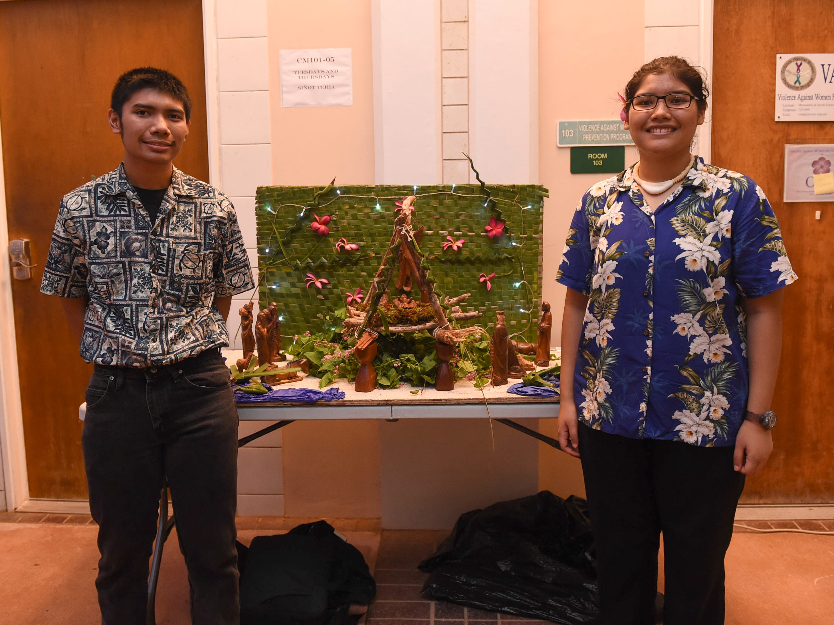 Students Kysha Concepcion and Edward Acfalle during the University of Guam Chamorro Studies Program's 2018 Christmas Celebration, Puengen Minagof Noche Buena! at the UOG Humanities and Social Sciences Building on Nov. 30, 2018.