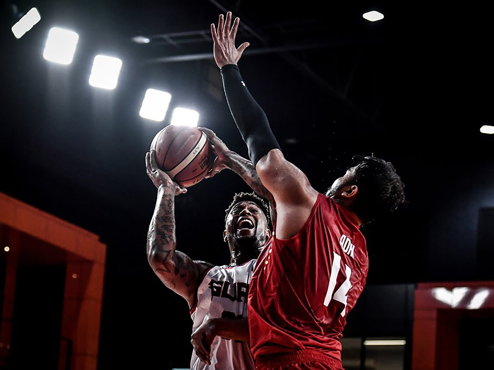 Guam's Earnest Ross goes for two hard points against Indonesia during their game Thursday night at the FIBA Asia Cup 2021 Pre-Qualifers.