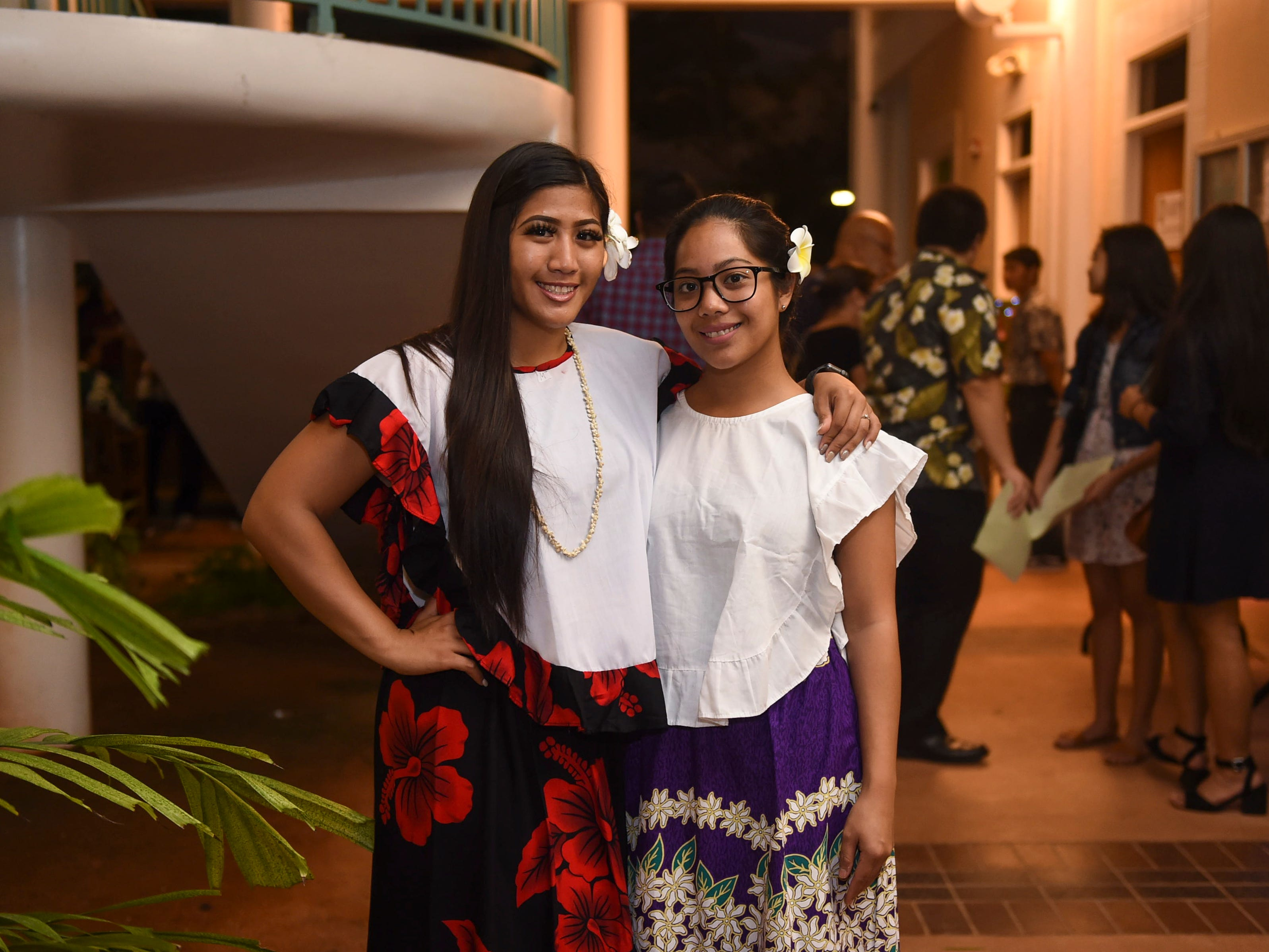 Students Celineeann Garcia, left, and Caitlyn Pangelinan pose in their mestizas during the University of Guam Chamorro Studies Program's 2018 Christmas Celebration, Puengen Minagof Noche Buena! at the UOG Humanities and Social Sciences Building on Nov. 30, 2018.