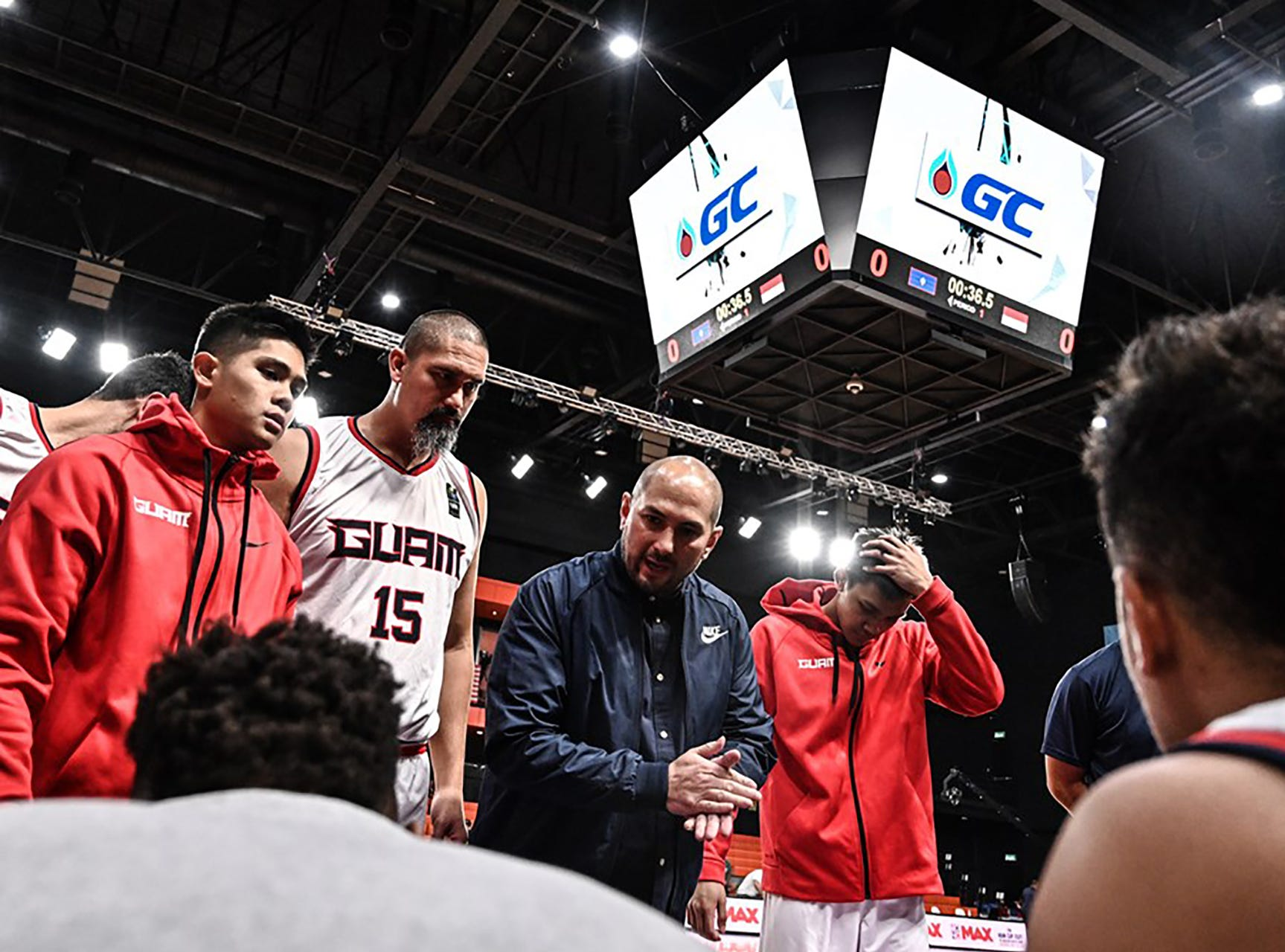 Team Guam coach E.J. Calvo with final words before Guam takes the court against Indonesia Thursday night at the FIBA Asia Cup 2021 Pre-Qualifiers.