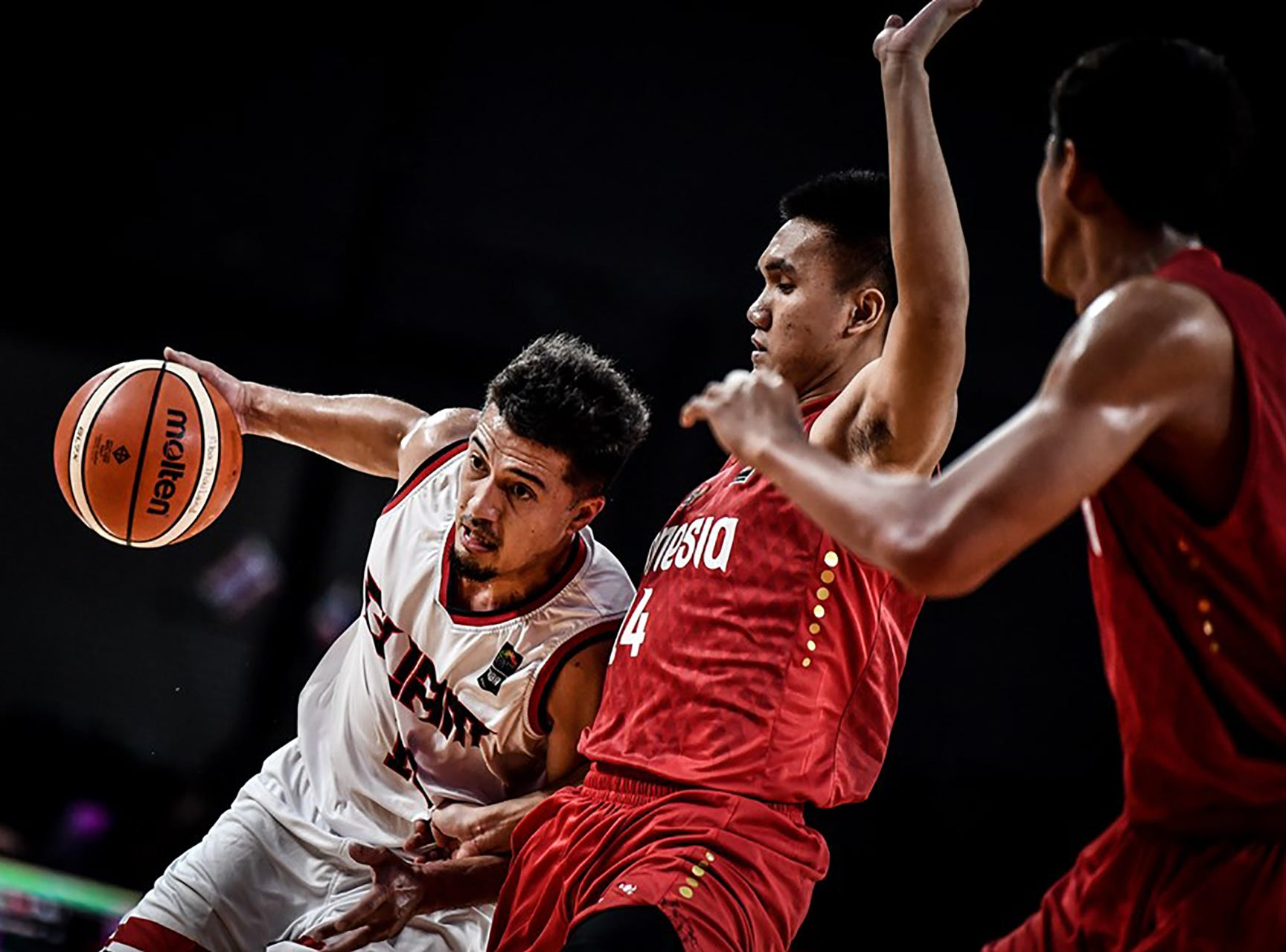 Team Guam's WIllie Stinnett goes low and around the defense in their game against Indonesia Thursday night in Thailand, at the FIBA Asia Cup 2021 Pre-Qualifiers.
