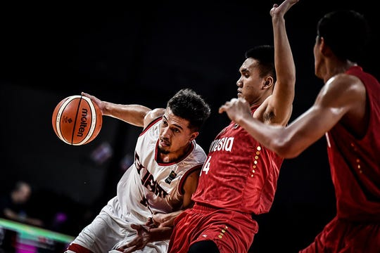 Team Guam captain Willie Stinnett drives around the Indonesia defense in this file photo from December 2018 in the FIBA Asia Cup Pre-qualifier. Stinnett and Team Guam will suit up once again for its biggest tests in 2020.