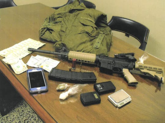 A rifle,  armor-piercing bullets, drugs, scales, a handgun and more were seized as part of a drug arrest by the Pennyrile Narcotics Task Force.