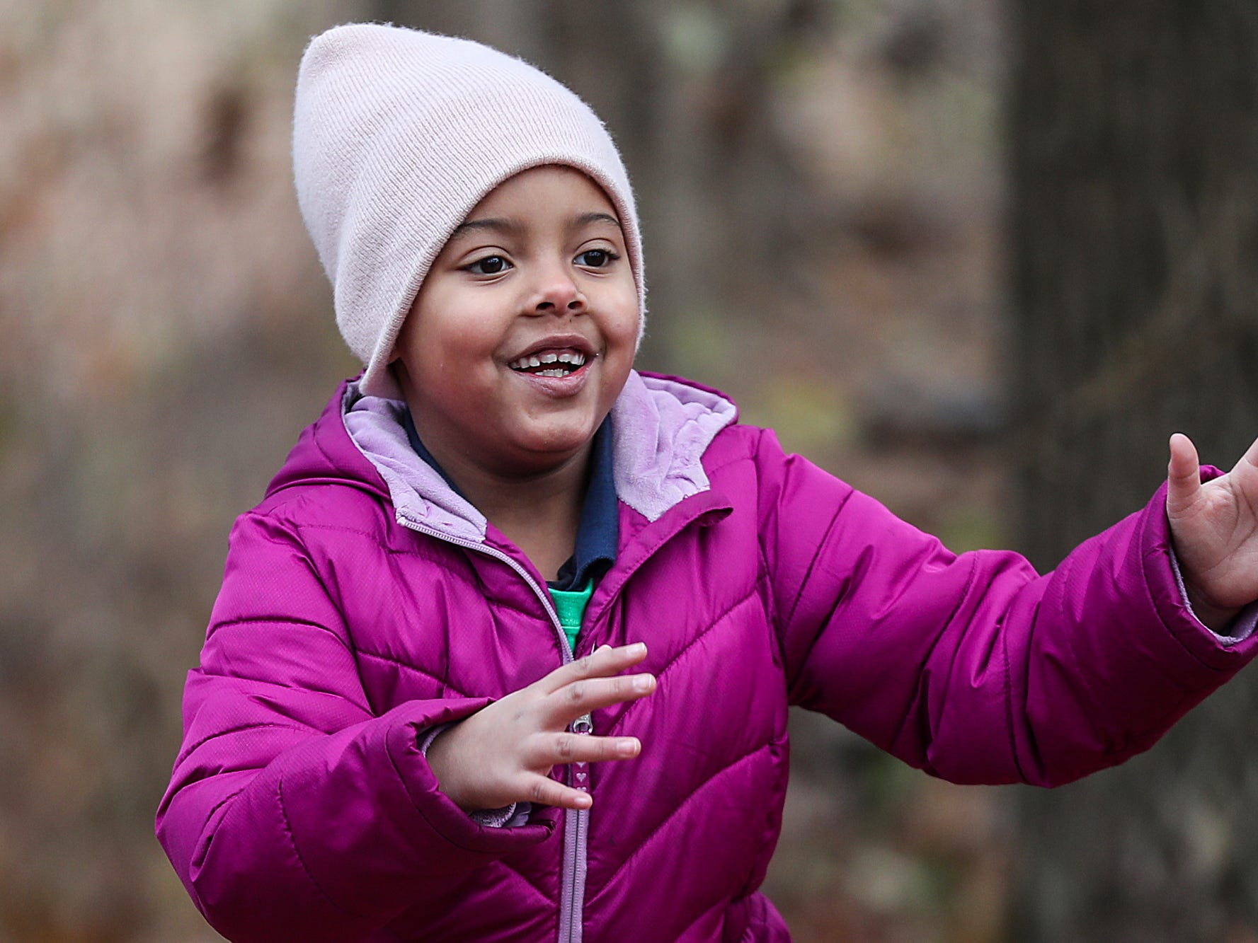 Faith Daniels, a second grader at Global Preparatory Academy, plays along a hike through the woods at Jameson Camp in Indianapolis, Friday, Nov. 30, 2018.