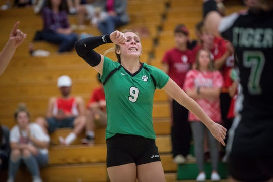 Yorktown's Kylie Murr celebrates a point in a win over New Castle on Oct. 4, 2018. The Tigers captured the HHC title with the victory.