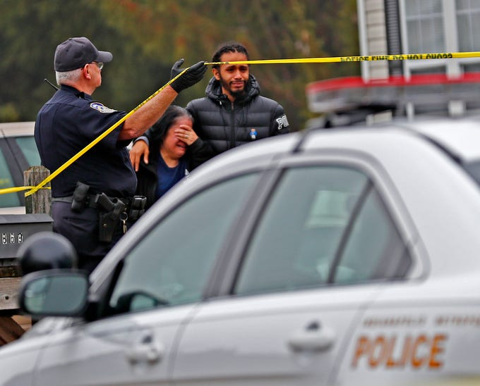 A distraught family leaves as the investigation continues at the scene of a homicide in the 3800 block of Amaranth Court, Friday, Nov. 30, 2018.